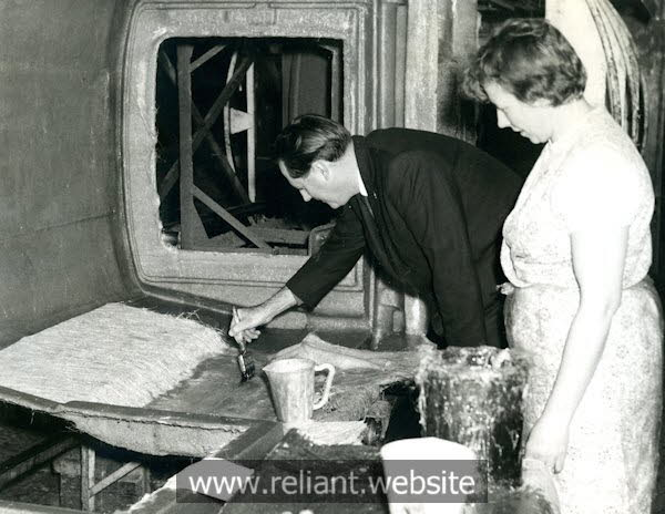 Hand laying fibreglass on a Regal Supervan